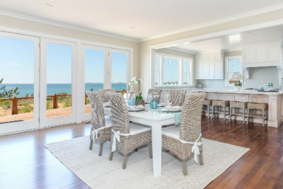 Photograph of Dining room with ocean in the background
