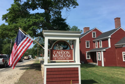 Photograph of Cahoon Museum, focusing on the sign with an american flag