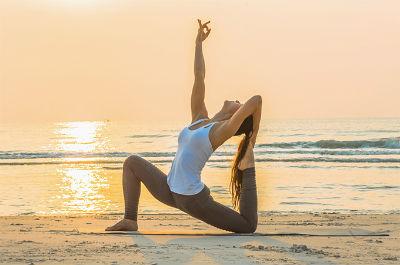 Yoga on the beach at sunrise