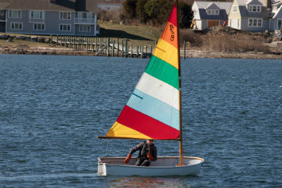 photograph of colorful sailboat on the water in Watch Hill, Rhode Island