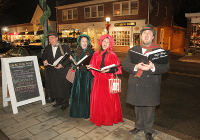 photograph of four Christmas Carolers at the osterville stroll