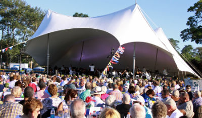 photograph of a Crowd listening to music under a tent at Pops in the Park