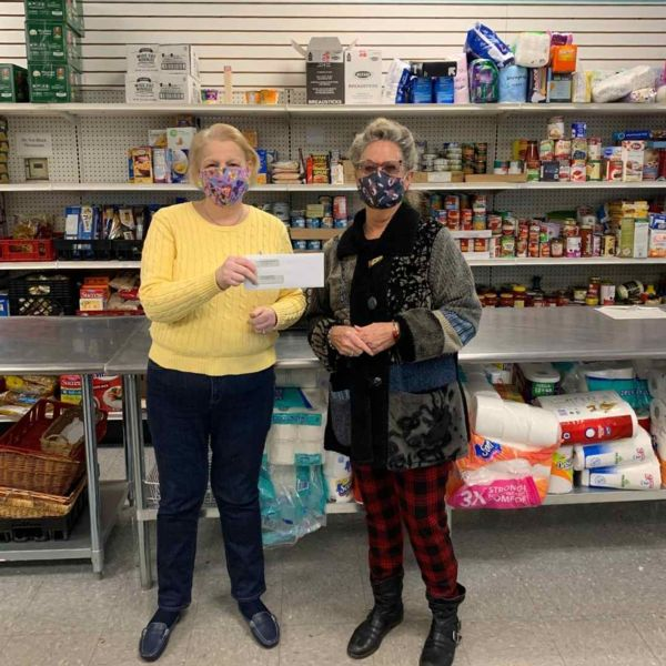 Photo of Annie Blatz presenting check to Susan Martin at Yarmouth Food Pantry