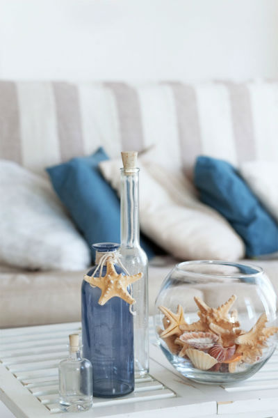 Starfish in glass vase on a coffee table