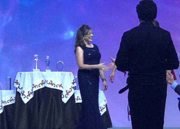 Dawn Stevens, Global Relocation and Corporate Services Director is presented with the Chairman's Service Award