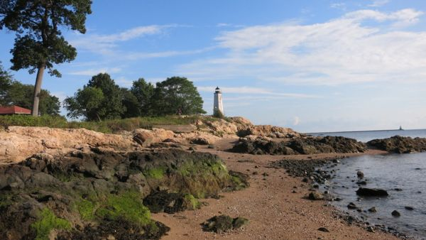 Photo of a beach with a lighthouse at low tide in East Haven CT