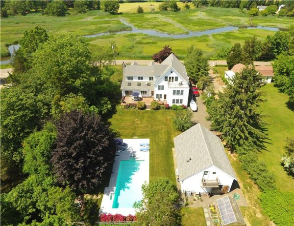 Photograph of riverfield house and a pool from above in Madison CT